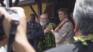 Governor Neil Abercrombie and Warden Ruth Coller-Forbes untying the maile lei