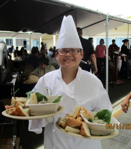 culinary student serving food