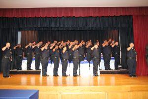 graduating class saluting