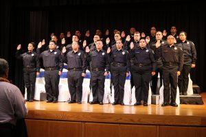 graduating class taking oath